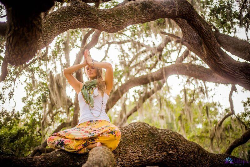 laura meditating in a tree